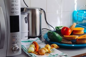 small appliances, a plate with vegetables, kitchen