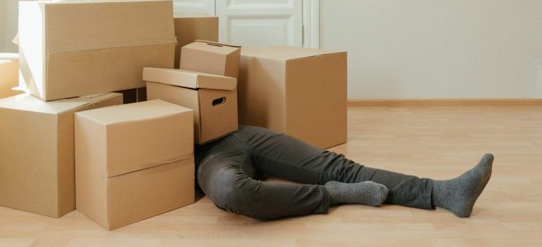 Man buried under the pile of boxes