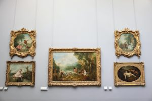 five paintings on the wall