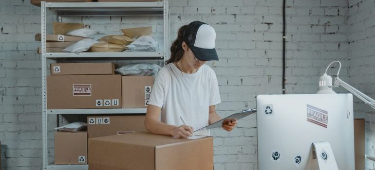 a girl that is packing items professionally