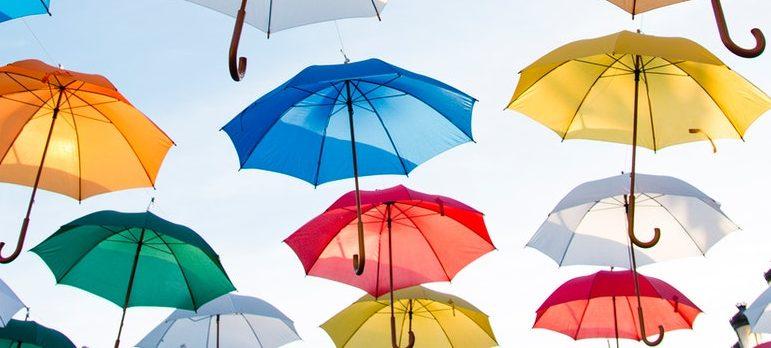 A dozen of flying umbrellas