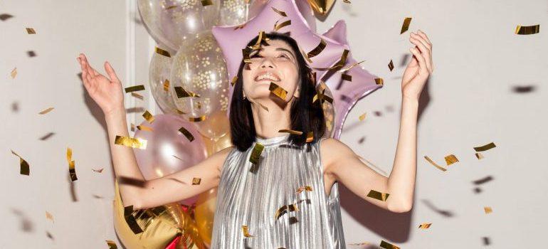woman looking at confetti falling