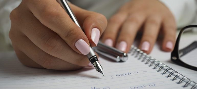 Girl writing on a piece of paper.