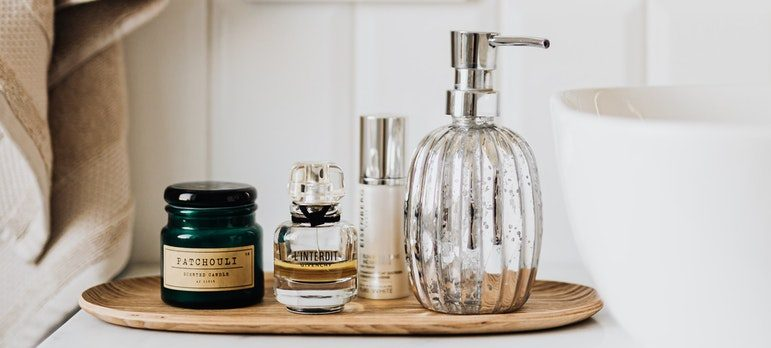 make storage space in your bathroom by using smaller containers