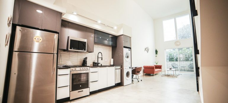 a wide angle of a kitchen with many kitchen appliances inside