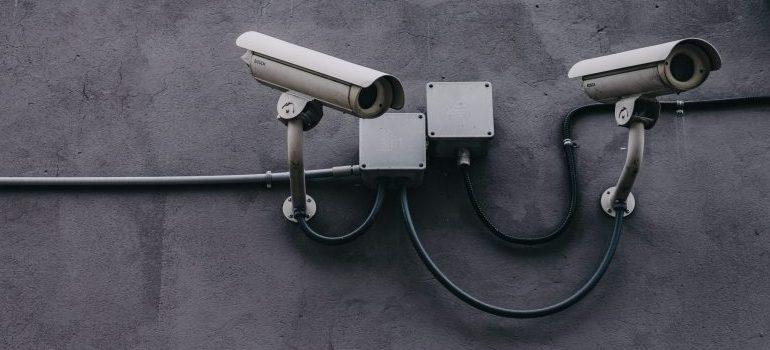 a couple of surveillance cameras