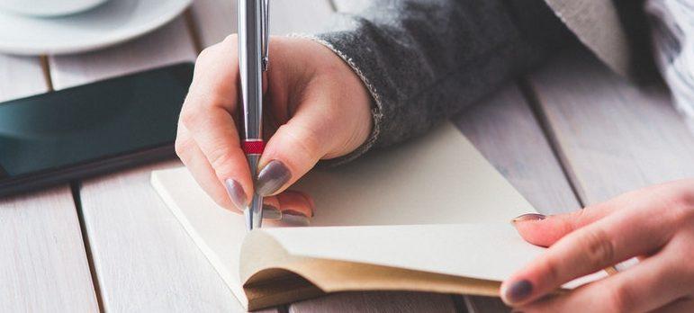 A woman creating a list