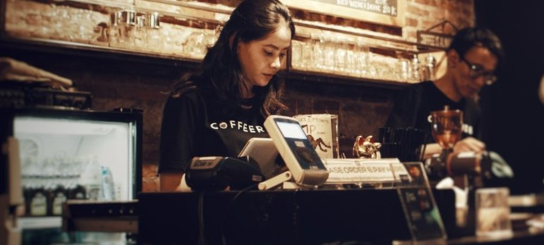 Cashier working at a coffee shop