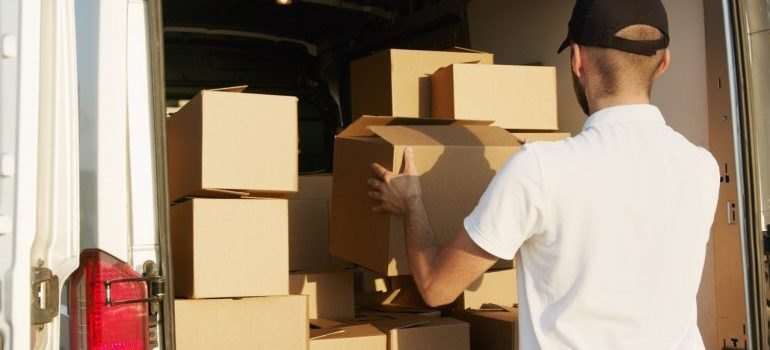 a man loading boxes in a truck
