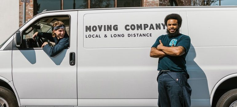 Two movers and a moving truck