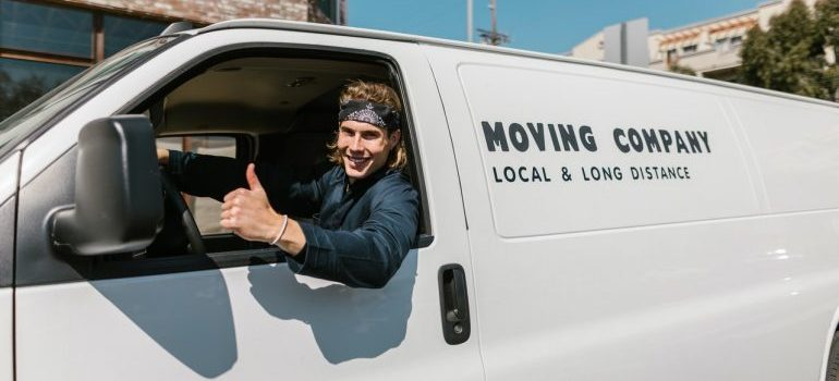 a young man in a moving company van