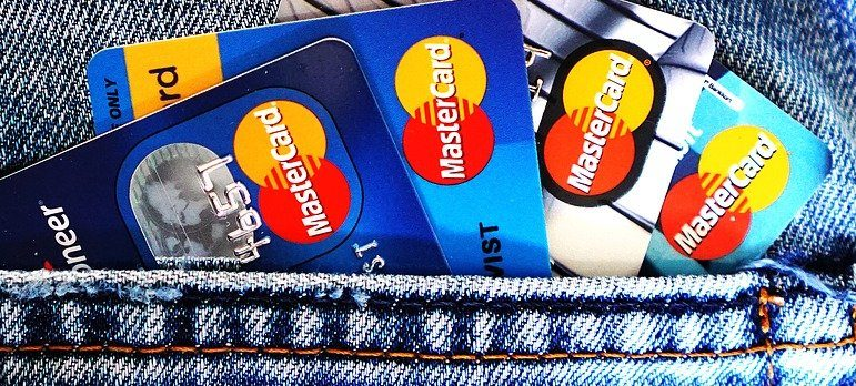 blue jeans with credit cards sticking out of the pocket