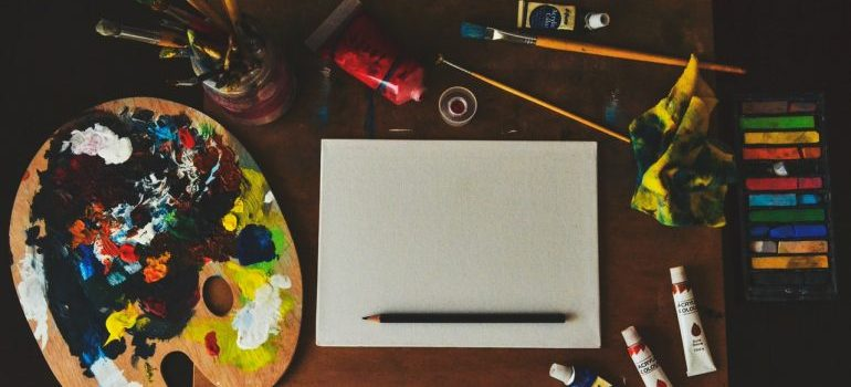 paints and pencil on the desk